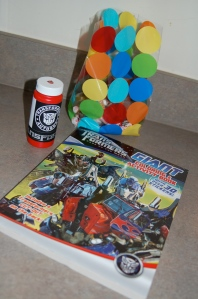 Goodies for the cousins: transformers bubbles (just printed off a something an taped them on myself), a Transformer coloring book, and a bag of candy!