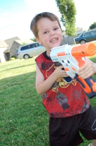 A whole lot of love for his water gun!